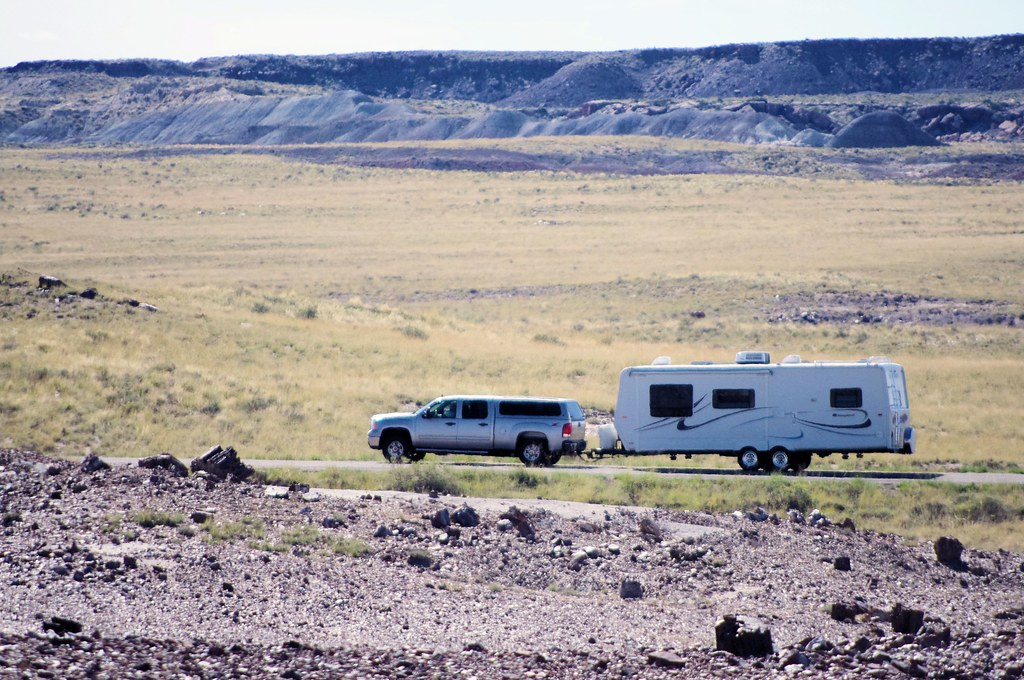 Photo Favorite: Pickup towing a bumper-pull travel trailer through Petrified Forest National Park, Arizona, October 9, 2011 (Pentax K-r)