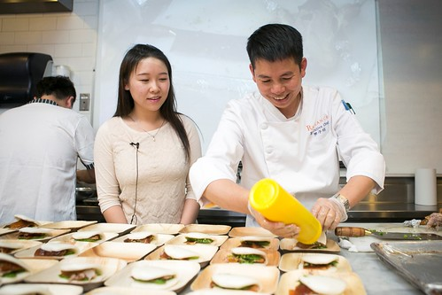 Chef Zizhao Luo (L) prepares the Crispy Duck Skin for the Taste Asia Food Festival Press Tasting at the International Culinary Center in Manhattan, New York, on June 10, 2015. (Samira Bouaou/Epoch Times)