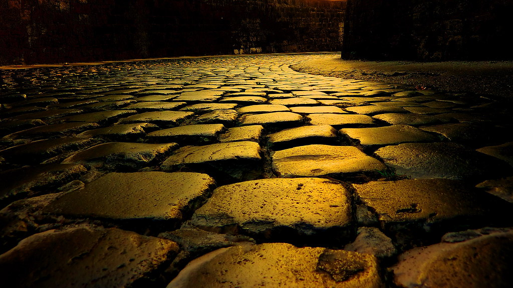 italy - cobble stone road abstract - yellow lighting