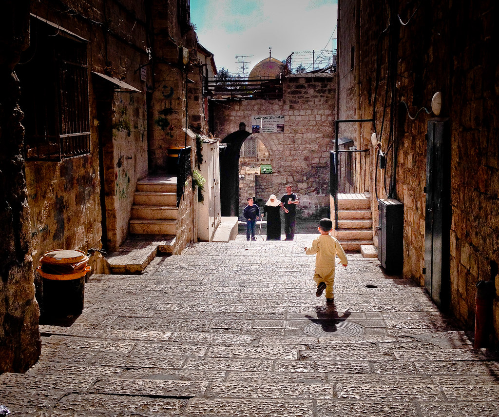 Young Palestinian Boy Running Down An Alley In The Arab Qu