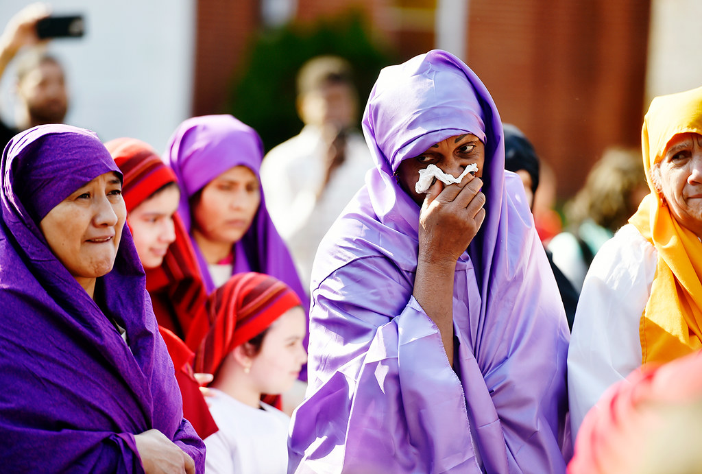 © 2016 by The York Daily Record/Sunday News. Lidia Monegro holds a tissue to her face as she and others perform as women of Jerusalem meeting Jesus Christ during a Good Friday street procession held by the Immaculate Conception of the Blessed Virgin Mary Church Friday, March 25, 2016, in York.