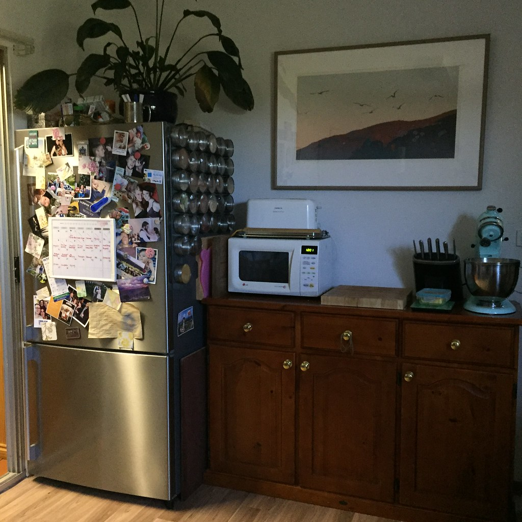 fridge covered in photos and bits and a sideboard for our crockery, cutlery, glassware and appliances