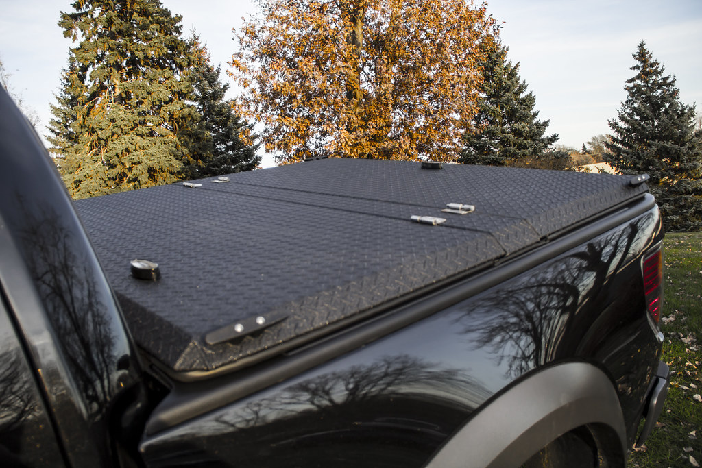 Black Folding Truck Bed Cover On Black Ford F 150 Raptor