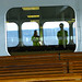 riding the ferry with neon shirts