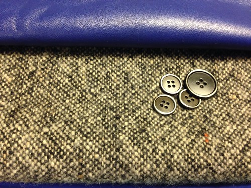 Tailored jacket materials: tweed, leather and metal buttons