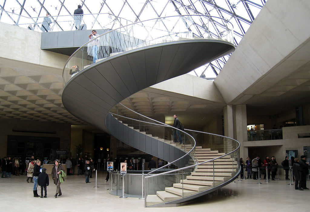 The Lobby And Spiral Staircase Of The Louvre Paris Its