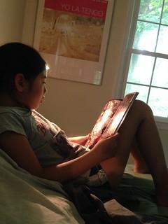 Maya engrossed in Lumberjanes, Volume 1