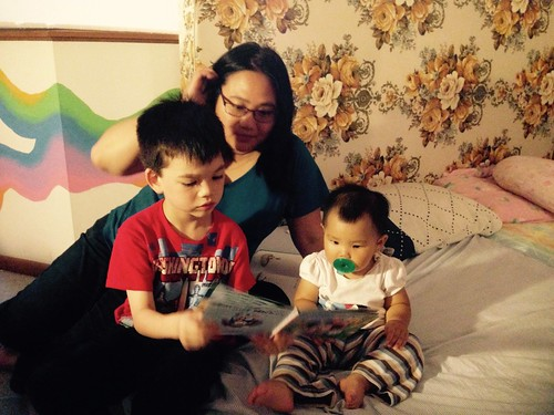 Big cousin reading to little cousin