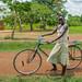 a girl and her bike near Busia