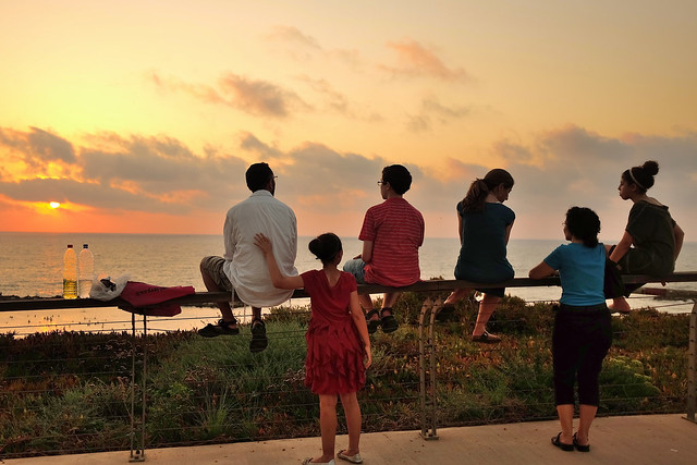 Friday evening, a family is watching the sunset