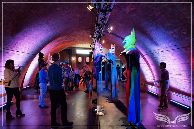 The Establishing Shot: BATMAN: ARKHAM KNIGHT CAPE & COWL EXHIBITION - L-R TRIBAL KNIGHTS BY INKIE & SOMEWHERE ON THE SPECTRUM BY CYCLOPS - KACHETTE, LONDON