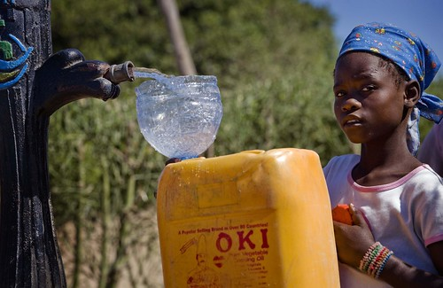A girl collects water from a stand pipe in Costa del Sol near Maputo, Mozambique