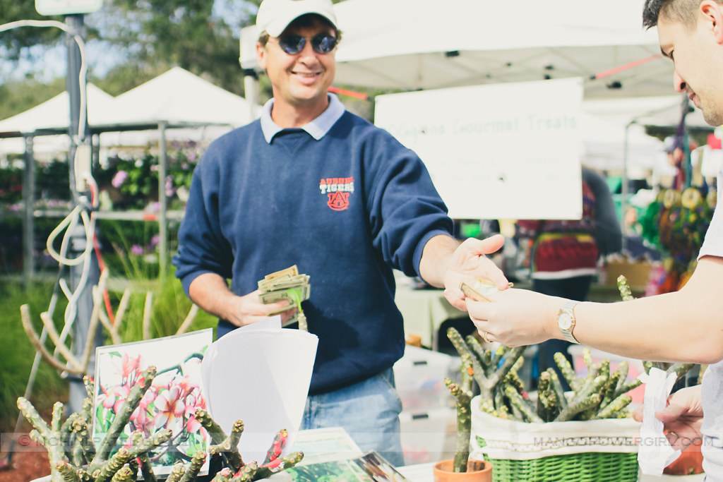 Brian buying my plumeria branch from Just Plumerias at winter park farmers market, florida