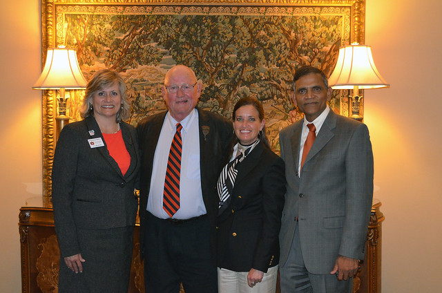 Gretchen VanValkenburg, James Earl Kennamer, Michelle Isenberg and Janaki Alavalapati pose for a group photo.