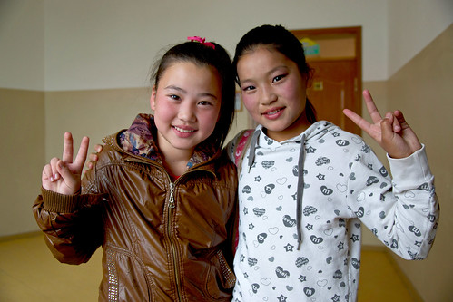 Two Mongolian girls in the hallway of their school | by World Bank Photo Collection