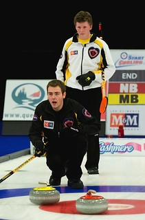 New Brunswick skip Rene Comeau reacts as Manitoba lead Brendan Calvert looks on during the men's final. | by seasonofchampions