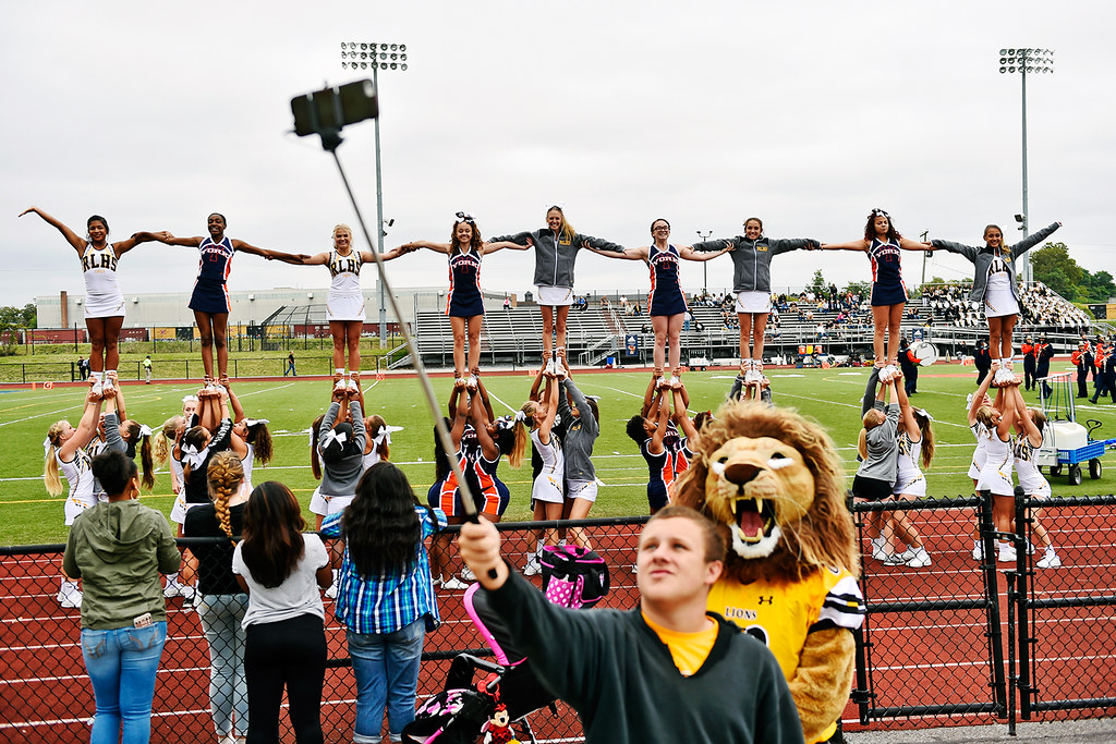 © 2016 by The York Daily Record/Sunday News. Red Lion cheerleader Dawson Kling holds up a phone on a selfie stick to take a selfie with mascot Leo the Lion and the Red Lion and William Penn cheer squads holding hands while performing pyramids before a YAIAA football game Saturday, Sept. 24, 2016, at Small Field in York.