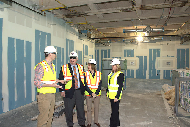 Ben Chapman, Timothy Boosinger, Marcia Boosinger and Diane Boyd stand in one of the 29 active learning classrooms being built in the new Mell Classroom Building.