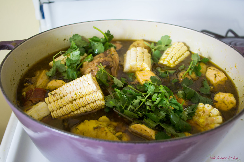 Dominican Sancocho: A hearty three meat stew filled with robust flavors of sazon, adobo and packed with hearty bites of yucca, plantain and corn.