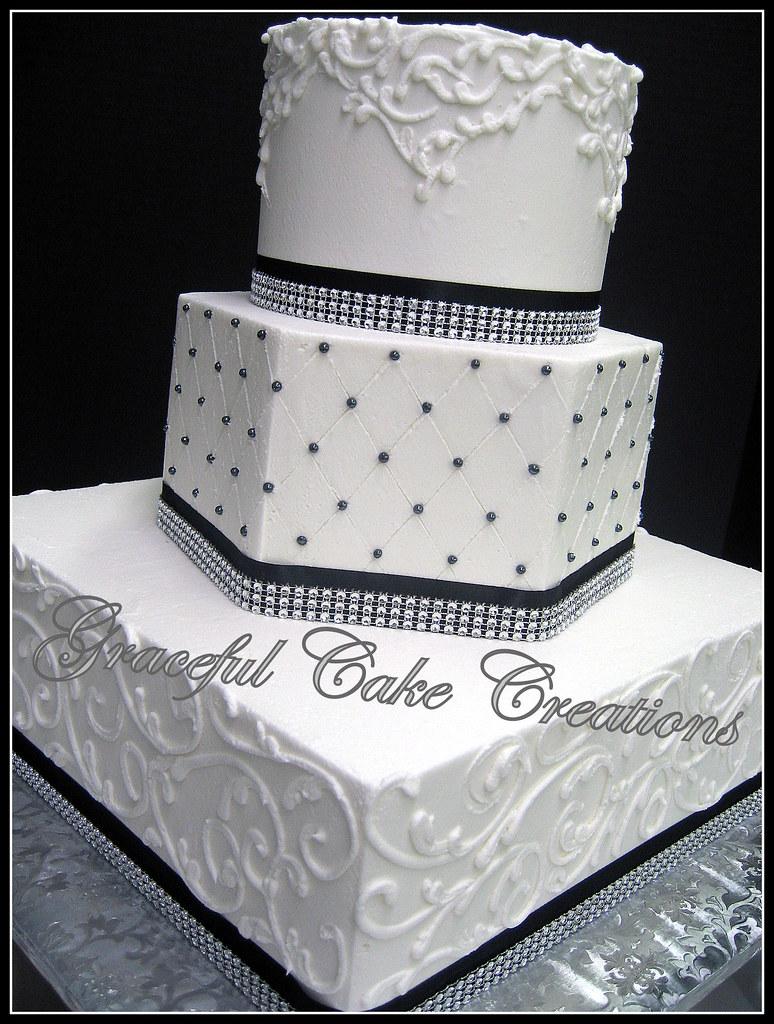 Elegant White Wedding Cake With Black Ribbon And Bling