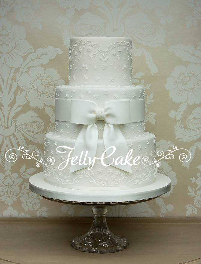 wedding cake with bow white lace and bow wedding cake a white version of my 26833