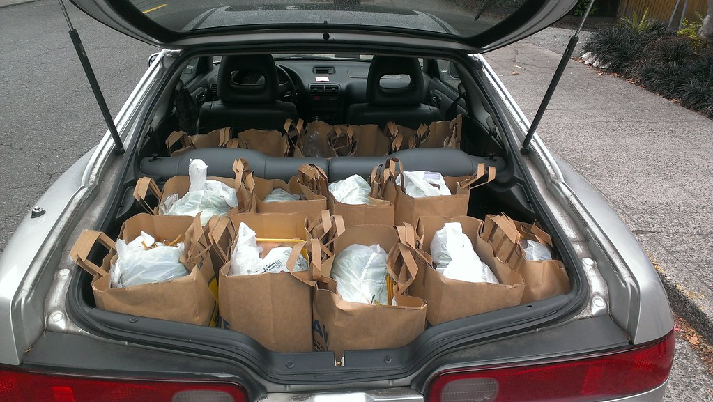 Car filled with paper and plastic bags