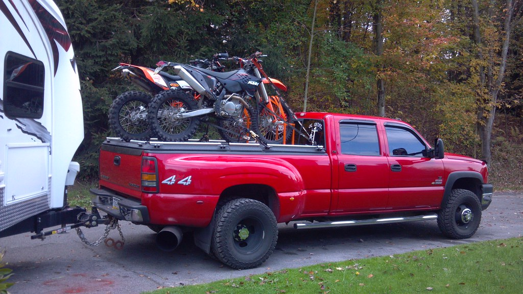 Dirt Bikes On Black Heavy Duty Truck Bed Cover On Pickup P