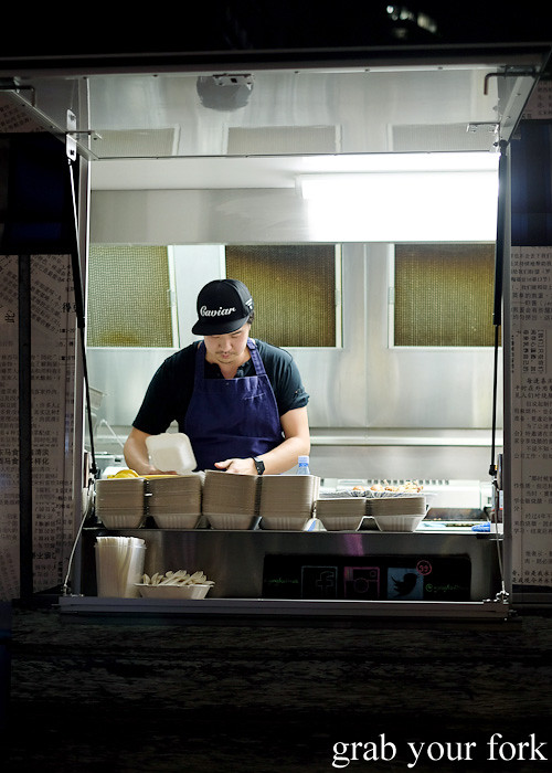 Head chef Alex Wong working onboard Yang's Malaysian Food Truck in Sydney