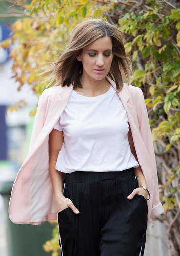 Wearing White t-shirt, pink blazer