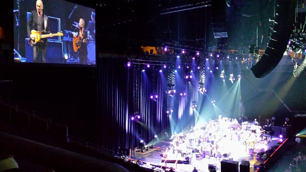 On guitar, totally at ease, Sting and Paul Simon concert ...