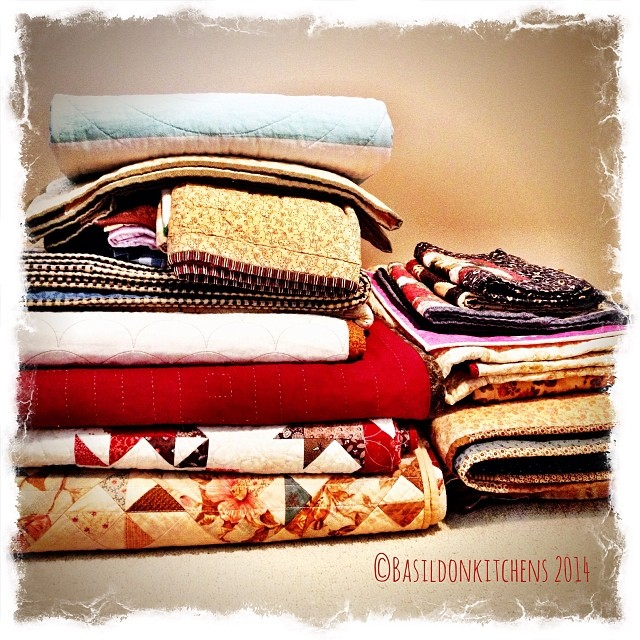 1/2/2014 - piles {a couple if 'piles' of quilts ready to be swapped out. My aim is to never be more than an arm's length from a quilt!  I'm close to succeeding,  #photoaday #piles #quilts #warmth #cuddly #love