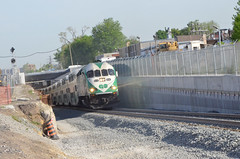This is a photo image of {MPI MP40PH-3C 618 GO Train coming out of the new fly under}