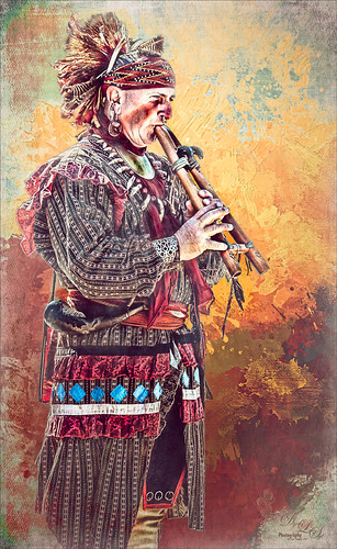 Image of Native American demonstrating Horn Playing