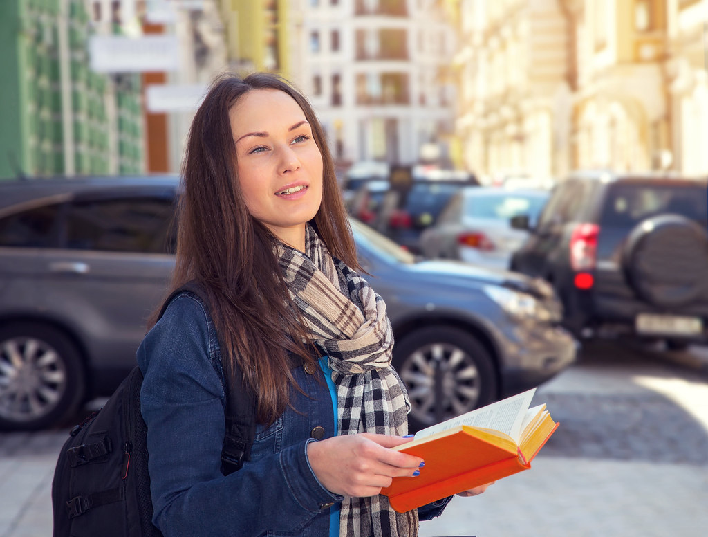 female student abroad reading a book