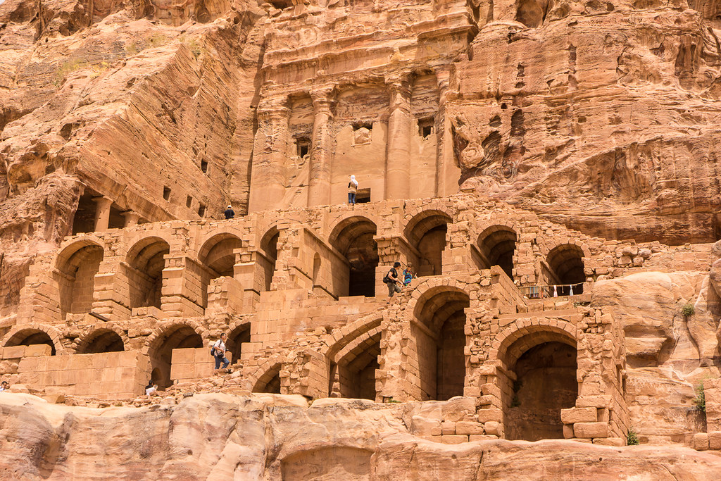 A grand building carved into the stone in petra jordan