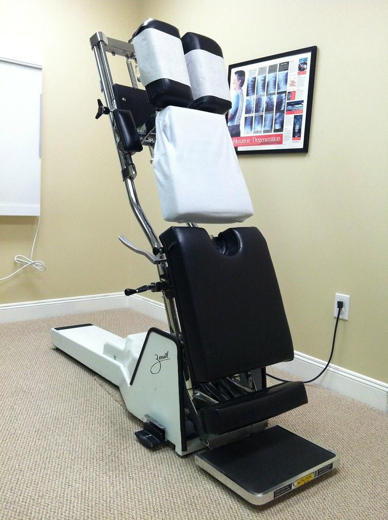 Chiropractic Torture Table | Chiropractor has her hands full ...