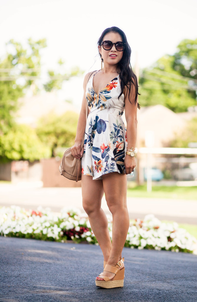 cute & little blog | petite fashion | floral criss cross strappy romper, bucket bag, tassel earrings | summer outfit