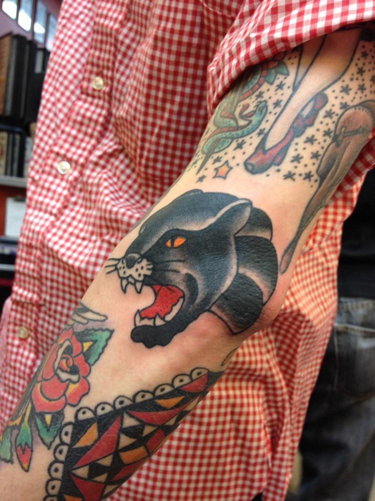panther head dagger tattoo
