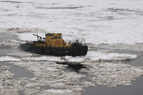 Icebreaker mounting a slab of ice