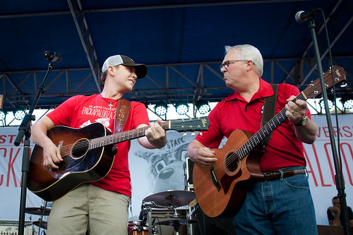 Scotty McCreery and Chancellor Woodson strum a few chords before they launch in their performance.