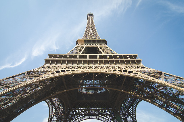 A view of the Eiffel Tower from below on a sunny day in Paris, France.