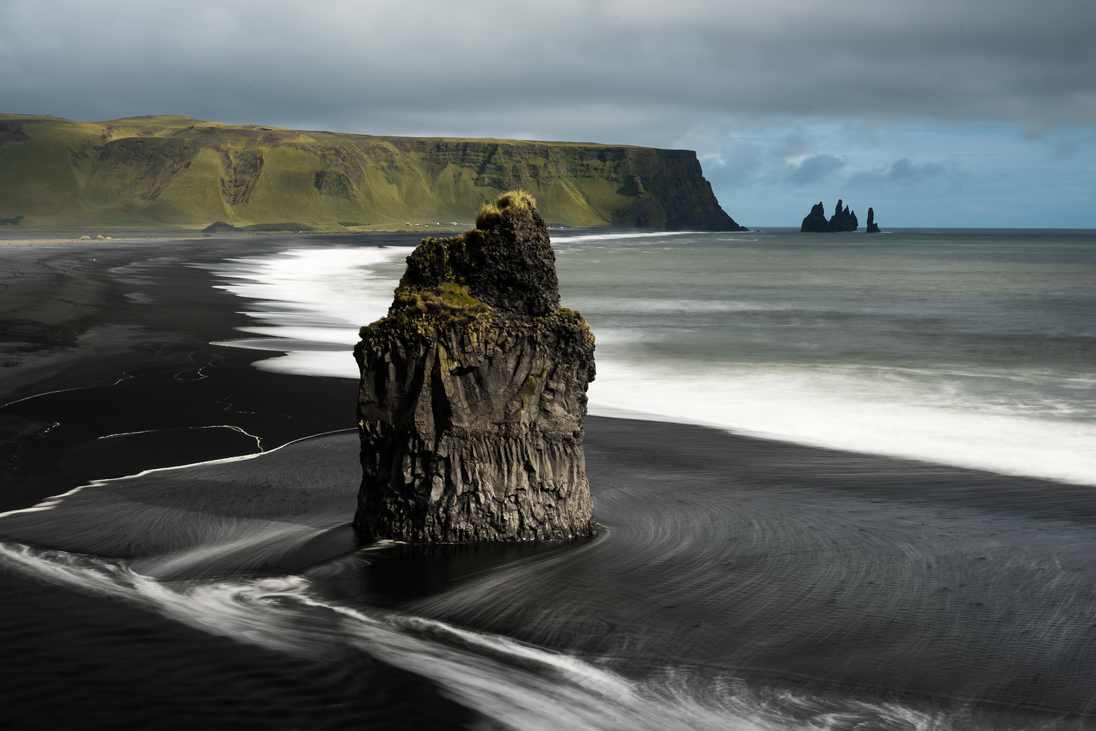 a basalt sea stack on a black sand beach in iceland 1600. Black Bedroom Furniture Sets. Home Design Ideas
