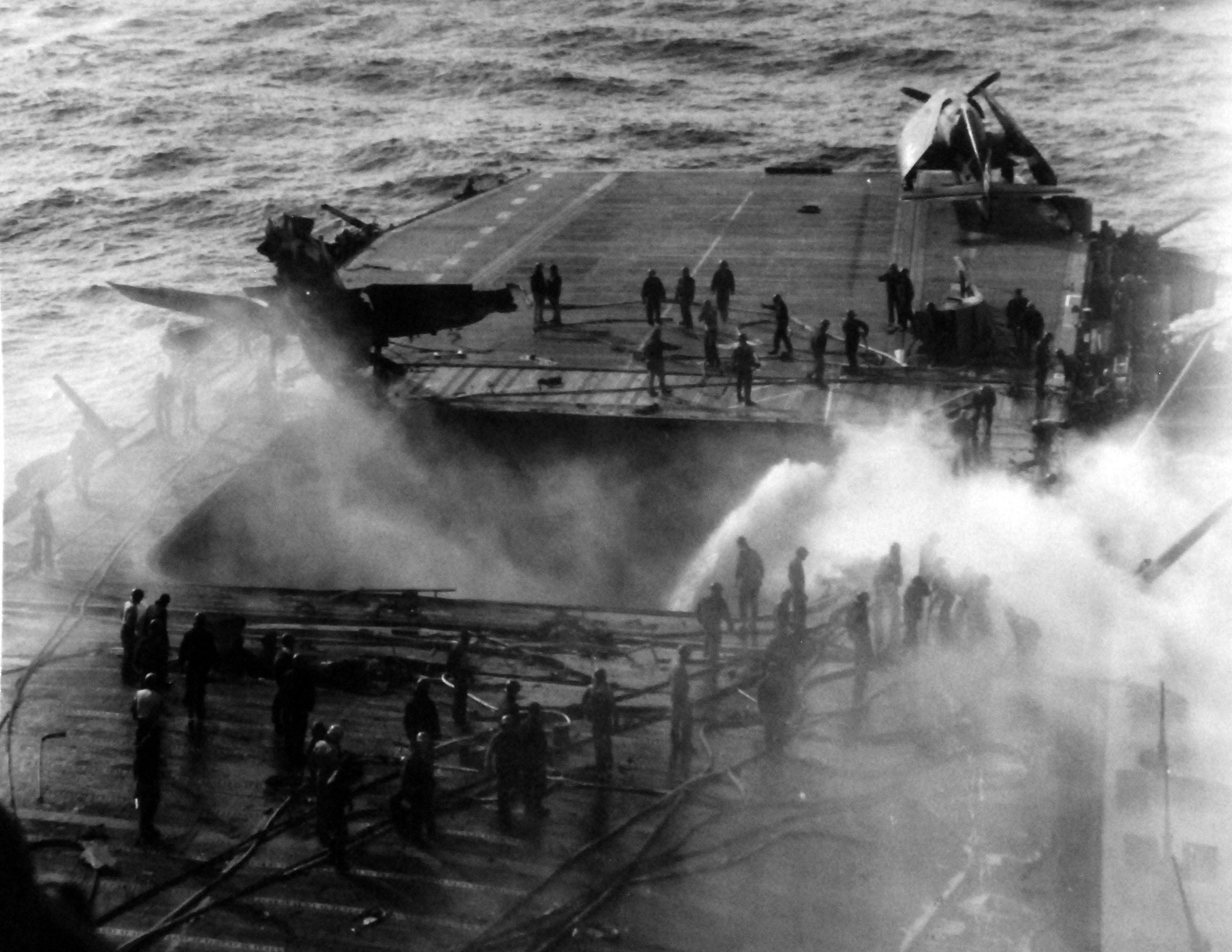 uss enterprise  cv 6  burning as a result of a japanese kamikaze attack on 14 may 1945