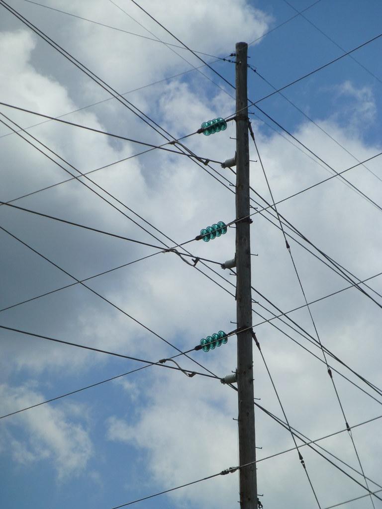 Power lines with aqua glass disc suspension insulators at for Glass power line insulators