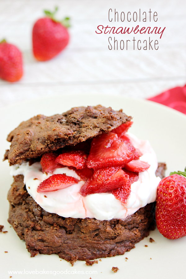 Chocolate Strawberry Shortcake on a plate with fresh strawberries.