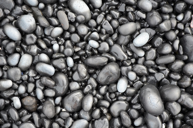black lava pebbles on beach flickr photo sharing