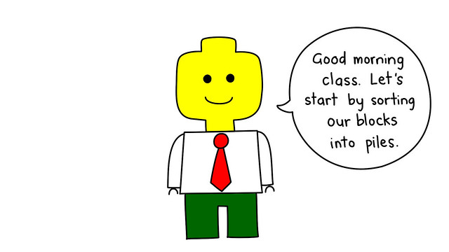 A Lego professor teaching a class.