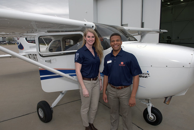 Recent Auburn graduate Ashley Tucker and junior Hampton McDonald are pictured in front of the Cessna Skyhawk 172 aircraft.