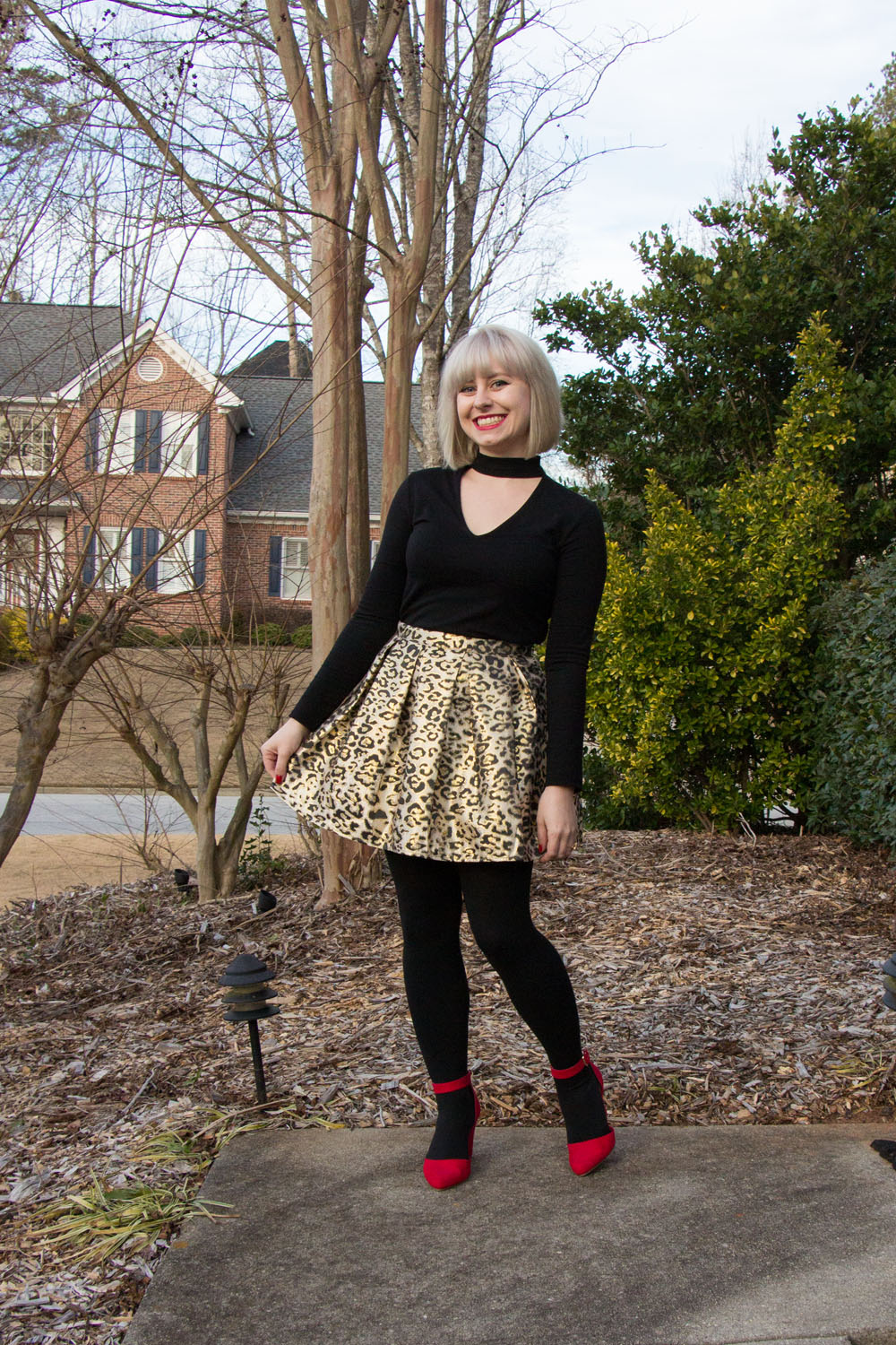 Metallic Leopard Print Skirt with Opaque Black Tights, Red Wedge Heels, and a Faux Choker Top