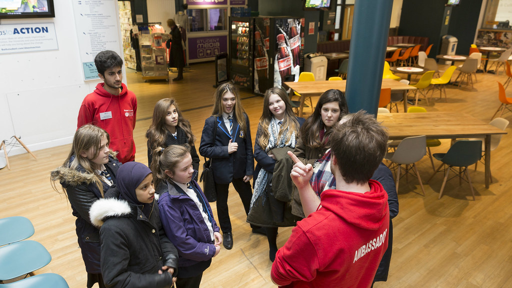 A group of female students in the Students' Union on a campus tour at a Futures Day